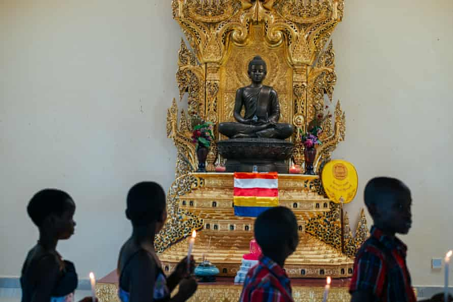 A statue of Mirembe, which means 'peace' in Luganda, watches over followers. The statue was made from metal offered by Thai people.