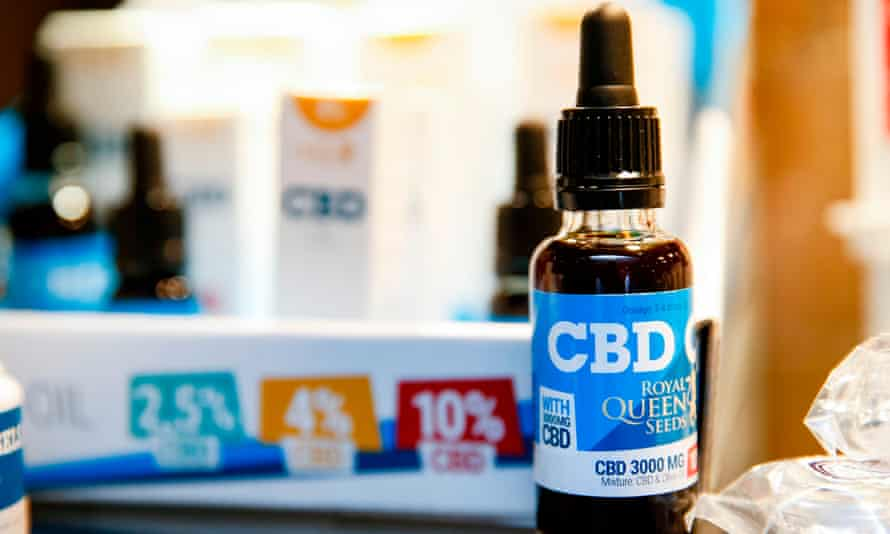 A bottle of oils containing CBD on display in a shop in Paris.