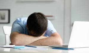 Man head-desking
