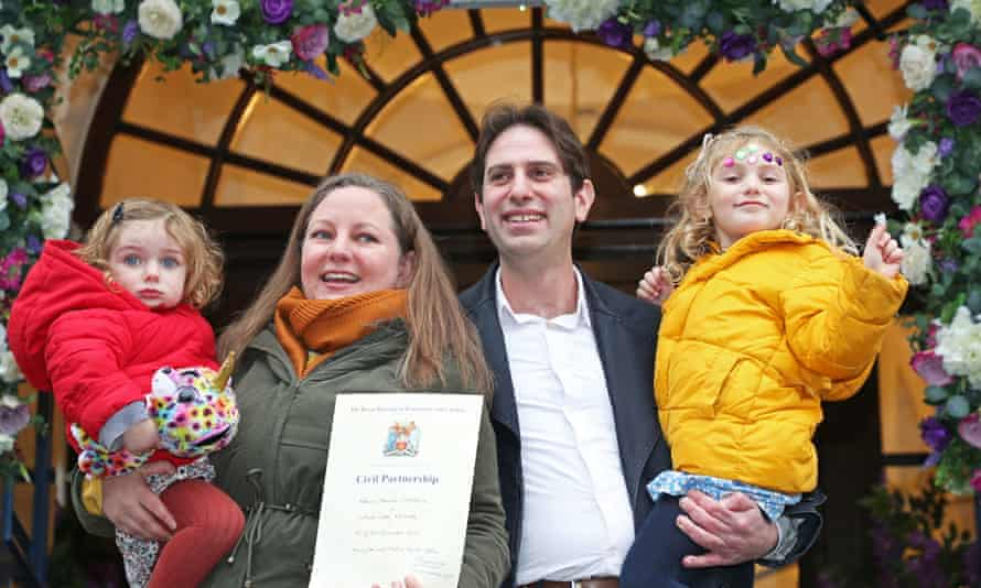 Rebecca Steinfeld and Charles Keidan, with their children Ariel and Eden, outside Kensington and Chelsea Register Office, London.