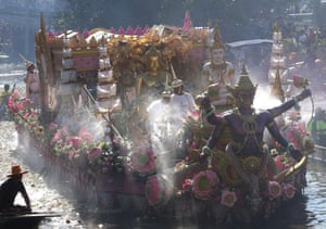 Bang Phli, Thailand Decorated boats carry a golden Buddha statue down the Bang Pakong River during the Rap Bua, or Lotus Flower Receiving festival, in Samut Prakan province