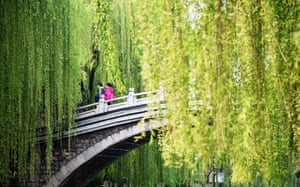 Shandong, China Pedestrians enjoy the Spring scenery by the moat in Jinan in east China's Shandong province