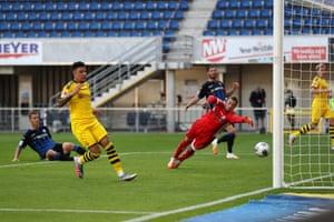 Dortmund's English midfielder Jadon Sancho scores his team's second goal.