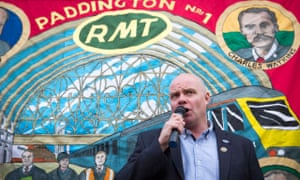"""Steve Hedley, senior assistant general gecretary of the Rail, Maritime and Transport (RMT) union, makes a speech to members of the union protesting outside Paddington station in London, as train services on some of the country's busiest routes will be """"significantly"""" hit because of a strike by rail workers."""