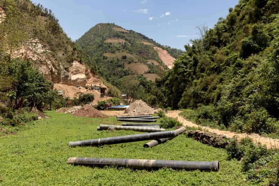 Steel pipeline lies stockpiled in a farmer's field in Kushadevi, Nepal