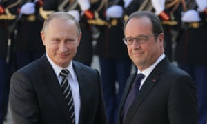 Putin and Hollande shake hands outside the Elysee Palace in Paris.