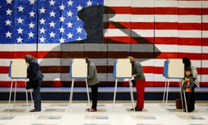 Voters line up in voting booths