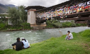 People relax by the river in Thimphu, Bhutan
