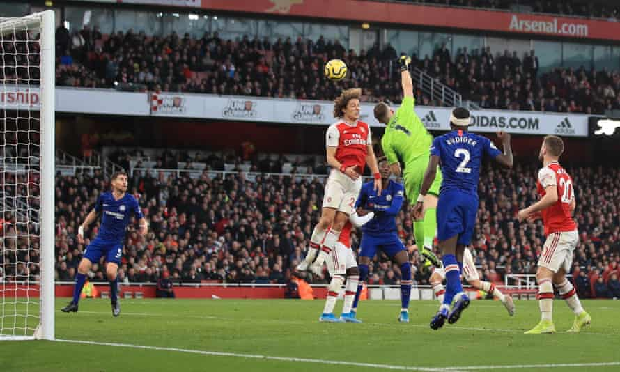 Bernd Leno and David Luiz of Arsenal fail to clear a Chelsea cross, allowing Jorginho (left) to score for Chelsea at the back post.