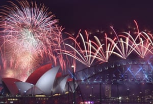 Fireworks light up the sky over Sydney's opera house and harbour bridge