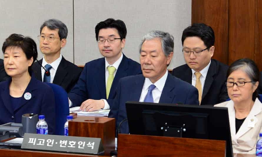 Former South Korean president Park Geun-hye (left) and her now-jailed confidante Choi Soon-sil (right) in a courtroom in the Seoul Central District Court.