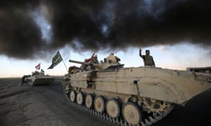 Iraqi forces advance towards Hawija during an operation to recapture the town from Islamic State.