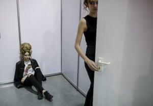 Models wait backstage during Ukrainian Fashion Week in Kiev.