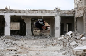 Parkour coach Ibrahim al-Kadiri, 19, demonstrates his Parkour skills amid damaged buildings in the rebel-held city of Inkhil, west of Deraa, Syria, February 4, 2017. Ibrahim and his team members say the sport is a challenge against the bad conditions they have to endure because of the war.