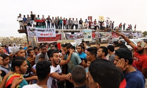 Libyans take part in a protest against a national unity government proposal by United Nations envoy Bernardino Leon, in Benghazi on 16 October.