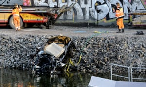 Badly damaged car is pulled out of a canal in Stockholm