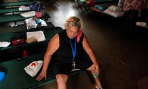 Sylvia Lamzo, 69, sits on a folding bed at an emergency center as Hurricane Irma approached Puerto Rico in Fajardo