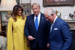 Prince Charles, Donald Trump and Melania Trump talk as they pose for photographs at Clarence House