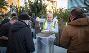 Homeless support charities Not Just Soup and Coffee4Craig providing food and clothing for homeless people in Piccadilly Gardens, Manchester.
