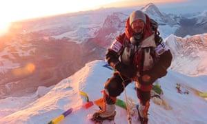 Nirmal Purja on the summit of Everest.
