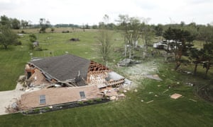 A tornado that swept through Indiana last month collapsed this garage, just across the state line near Celina, Ohio.
