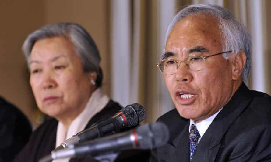 Tempa Tsering, right, the chief representative of the Dalai Lama in Delhi, speaks to the media alongside his wife, the Dalai Lama's sister Jetsun Pema