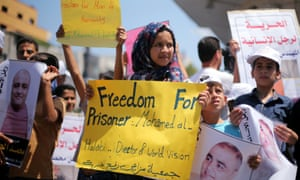 Palestinian demonstrators take part in a protest in solidarity with Mohammad El Halabi, World Vision's manager of operations in Gaza, in 2016.