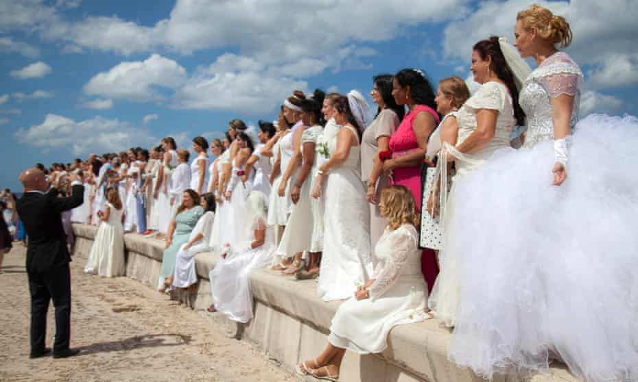 Church member gather to renew their marriage vows on Havana's Malecón.