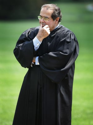 Supreme Court Justice Antonin Scalia listens to President Bush speak during a swearing-in ceremony on the South Lawn at the White House in June 2006