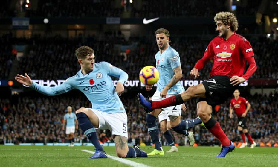 Stones challenges Marouane Fellaini in Sunday's derby win over Manchester United