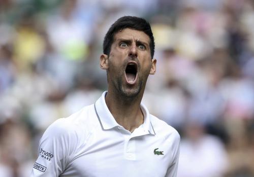 Serbia's Novak Djokovic celebrates winning a point against Roberto Bautista Agut of Spain during their men's singles semi-final at Wimbledon.