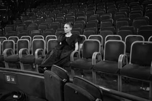 Rooney Mara waiting in the auditorium after the ceremony while her partner Joaquin Phoenix is photographed on stage
