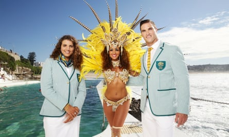 Australian athletes Jessica Fox and Ed Jenkins pose with a Brazilian dancer while modelling their Rio 2016 opening ceremony uniforms.