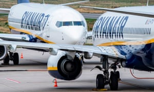 Two Ryanair planes on the tarmac of an airport