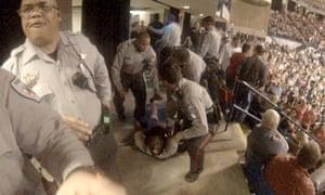 Cops atop protester Rakeem Jones in a video still.