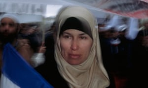 A French Muslim demonstrates against the banning of headscarves.
