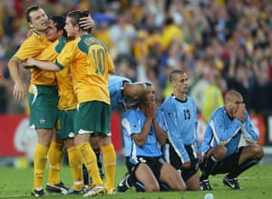 Mark Viduka, pictured getting a hug from Tim Cahill and Harry Kewell, missed his penalty in the shootout.