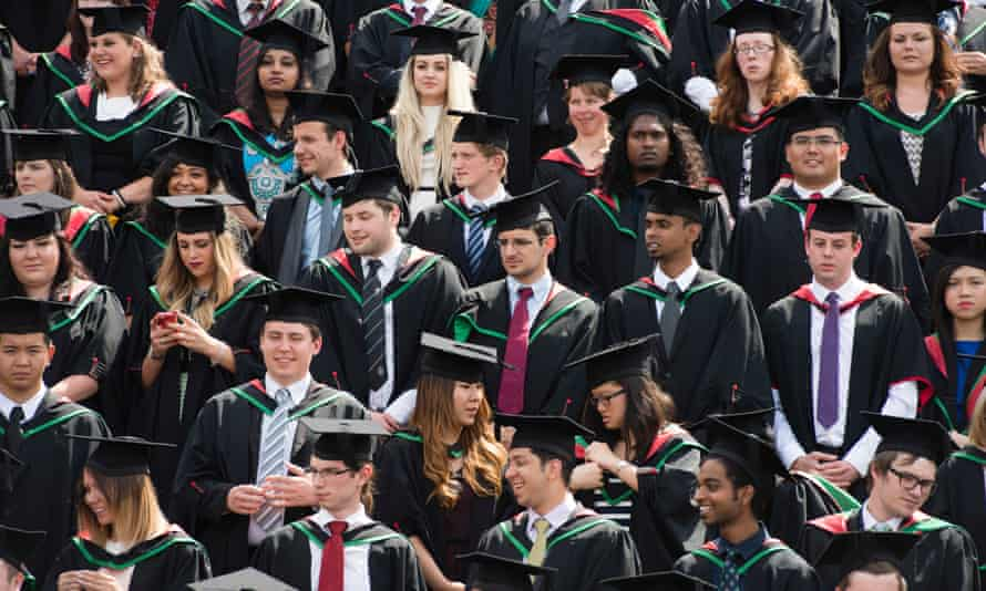 Students in their traditional gowns and mortar boards graduating on graduation day at Aberystwyth University.