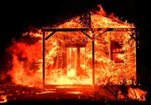 Flames overtake a structure as nearby homes burn in the Napa wine region