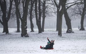 Glasgow, Scotland. People sledging in Queen's Park. Forecasters say the cold spell affecting much of the UK is set to continue, with temperatures expected to remain slightly below average into next week