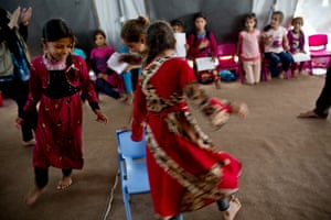 Young girls play in a child friendly space run for them by War Child UK at camp for displaced people near Dohuk, Iraq