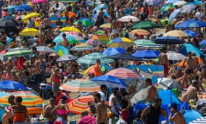 People enjoy the hot weather at the beach in Bournemouth.