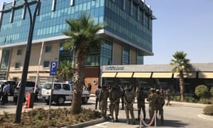 Security forces in Irbil stand guard after at least three Turkish consulate employees were killed in an armed attack on a restaurant.