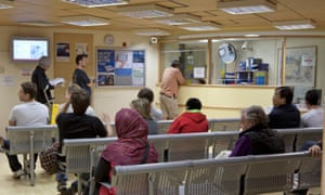 Patients in a waiting room at the Royal Free hospital in Hampstead, north London.