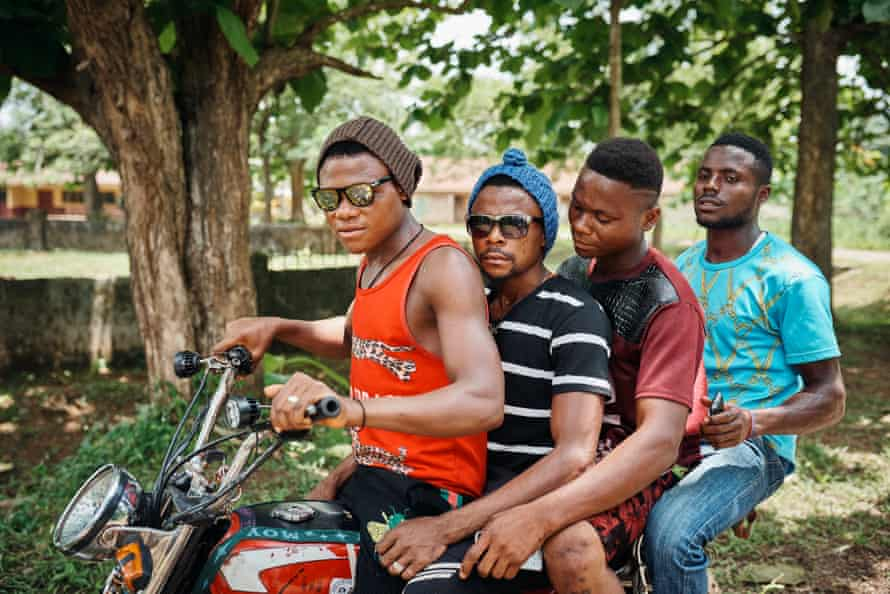Cameroonian refugees on a motorbike
