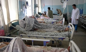 People injured in the Kabul airport attacks receive medical treatment at a local hospital.