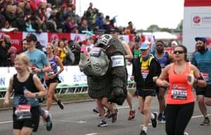 A runner dressed as a rhino