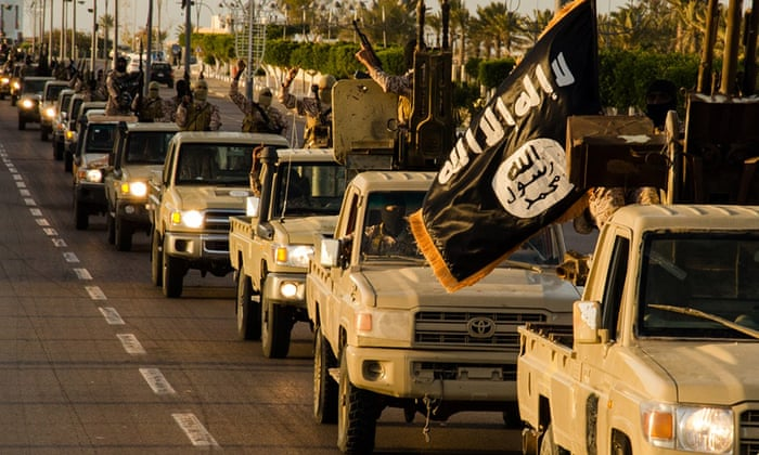 Islamic State (Isis) fighters parade in Sirte, Libya, in early 2015: the group is reportedly growing in strength as jihadists relocate from Syria.