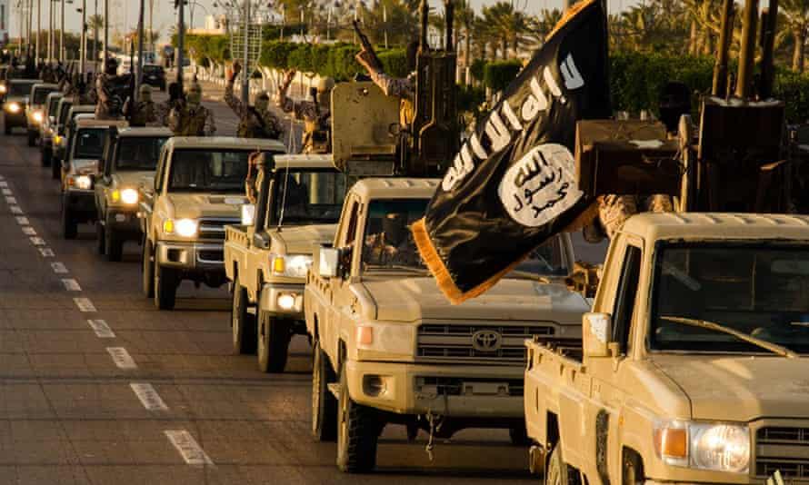 Alleged members of Isis parading in a street in  Sirte, Libya