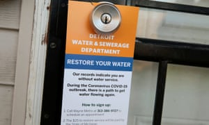 A notice by the Detroit water and sewerage department hangs on a house doorknob to inform residents how to restore service in response to the coronavirus outbreak, in March.